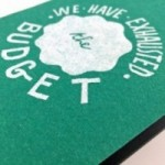 "Notes tascabile ""We have exhausted the budget"", copertina verde smeraldo e interno in carta colore nero"